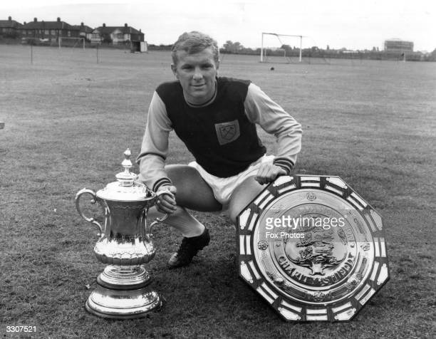 West Ham United captain Bobby Moore with the FA Cup and Charity Shield trophies