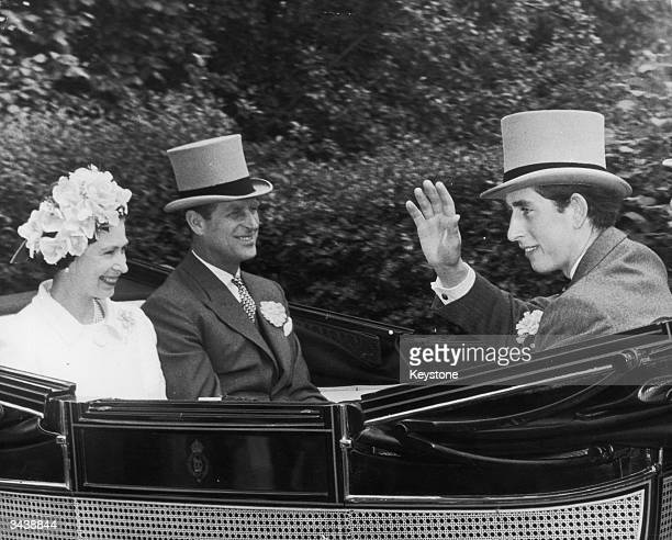 Prince Charles, Queen Elizabeth II and the Duke of Edinburgh pass through the village of Cheapside on their way to the Ascot race meeting.