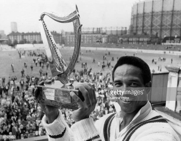 The captain of the Rest of the World Cricket team Gary Sobers with the Guinness Trophy, after his team beat England at the Final Test match held at...