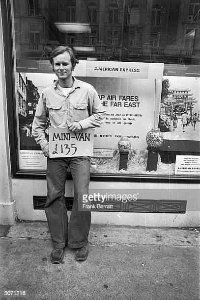 American traveller Terry Beier from Arizona outside the American Express offices in the Haymarket London with a sign advertising a MiniVan for sale...