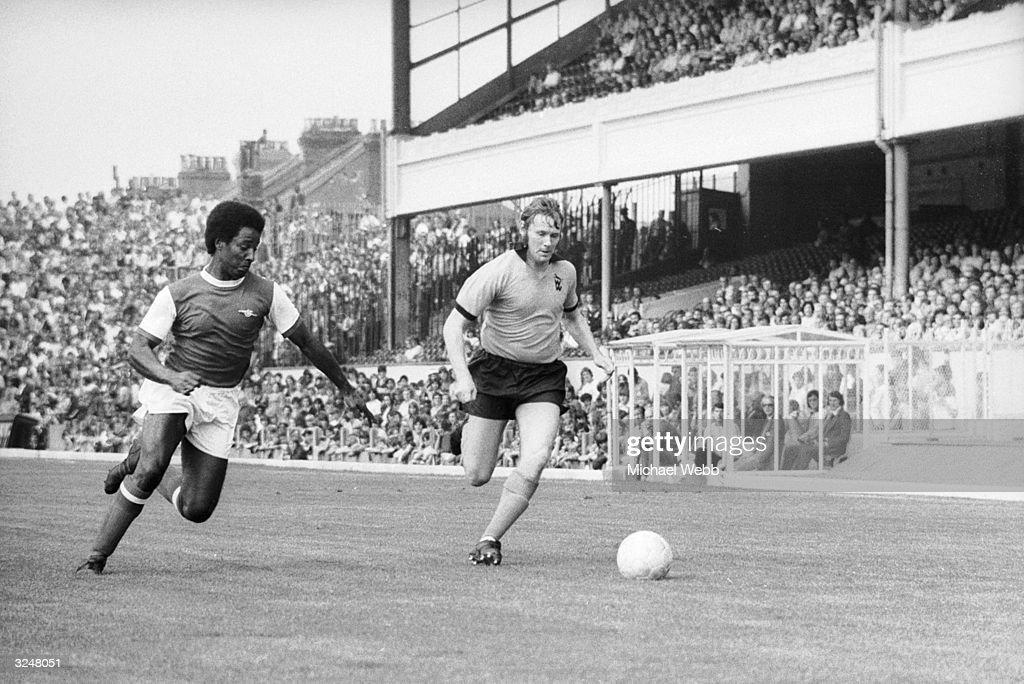 Brendan Batson of Arsenal and Wolverhampton's Jim McCalliog converge on the ball during a 3rd and 4th place play-off match at Highbury, for the FA Cup.