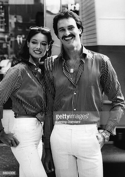 Michelle and Michael modelling satin striped shirts from Van Heusen's Saville collection