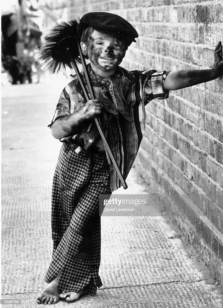 Four year-old Tommy Stafford dressed as a chimney-sweep for the fancy-dress competition at the East Street Market centenary celebrations, London.