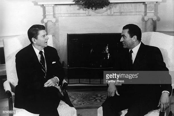 Mr Hosni Mubarak the Egyptian President having a meeting with President Ronald Reagan of America in Washington.
