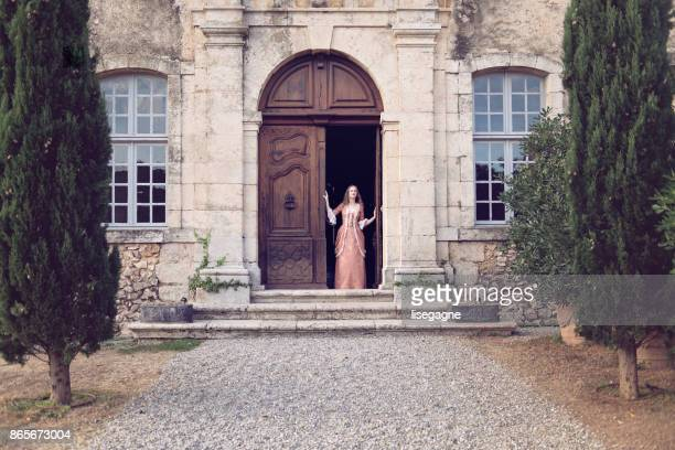 18th century woman in a castle - castle stock photos and pictures