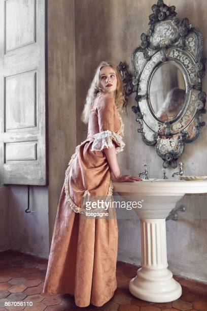 18th century woman in a castle - pink dress stock photos and pictures