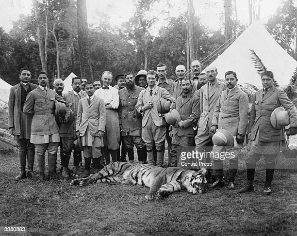 The Prince of Wales later Edward VIII posing with the first tiger he ever shot on his tour of Nepal India