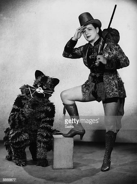 Actress Nuna Davey as Dick Whittington with a cat in costume during a production at London's Players Theatre
