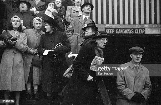 Gamblers watching a race at White City Greyhound Racing Stadium London Original Publication Picture Post 1590 The Dogs In Wartime pub 1943