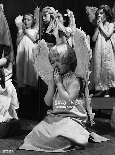 A child playing a praying angel during her school nativity play Original Publication Picture Post 7440 The Youngest Children In The Oldest Play pub...