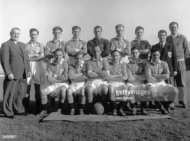 The Blackpool football team Back row left to right Joe Smith H Kelly R Gratrix E Fenton G Farm T Garrett J Kelly J Lynos E Hayward Front row...