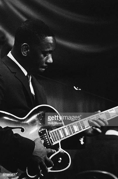 Musician Wes Montgomery plays guitar on stage at the Jazz Gallery New York City