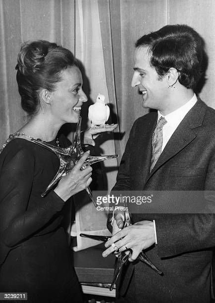 French actress Jeanne Moreau and director Francois Truffaut with the awards they received for the classic film 'Jules et Jim'