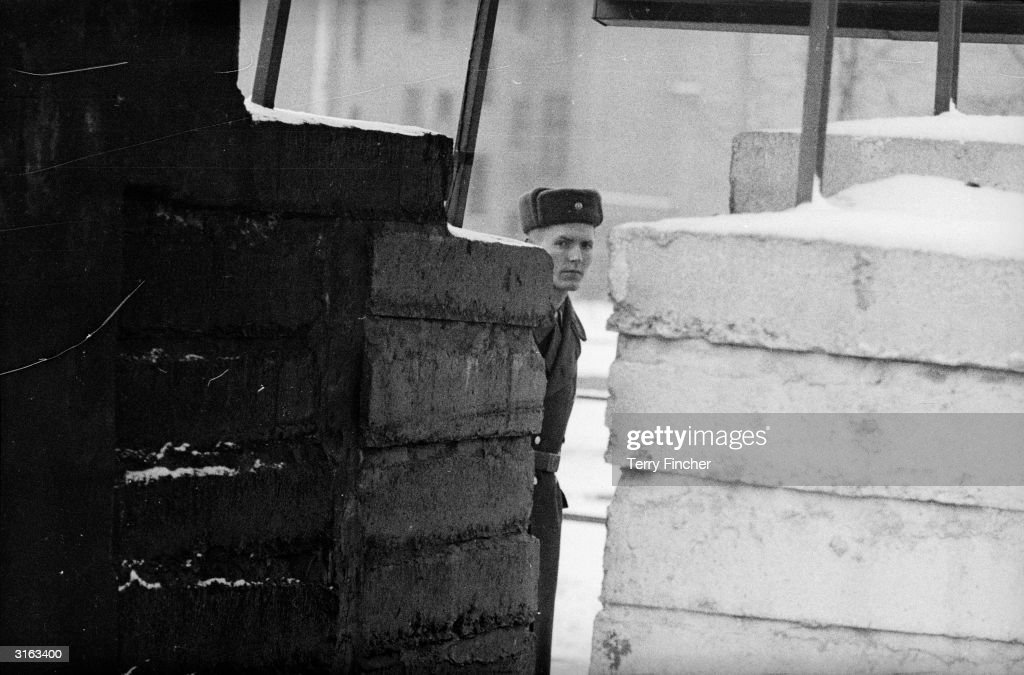 A guard patrols the border between East and West Berlin.