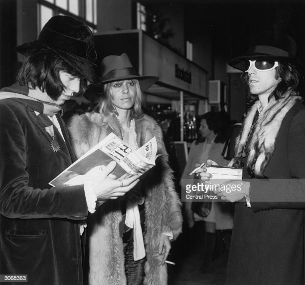 Rolling Stones singer Mick Jagger and guitarist Keith Richards with actress Anita Pallenberg in a departure lounge at London Airport