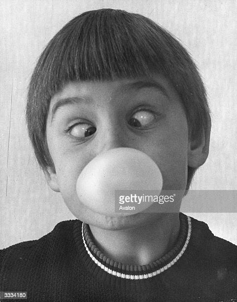 Tommy Sears going crosseyed while blowing the prizewinning bubble in a bubblegum blowing competition in Orpington Kent