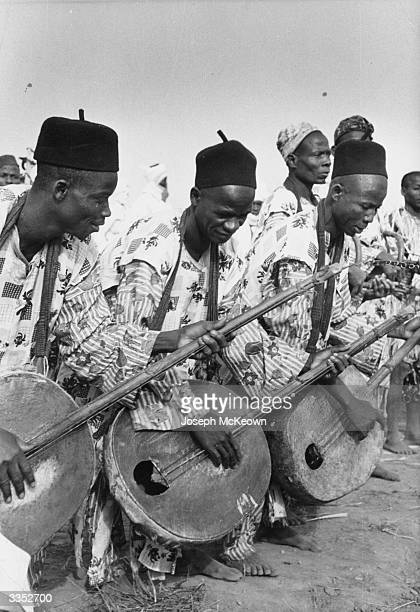 Nigerian musicians playing traditional stringed instruments during the Queen's visit to Nigeria Original Publication Picture Post 8274 The Queen In...