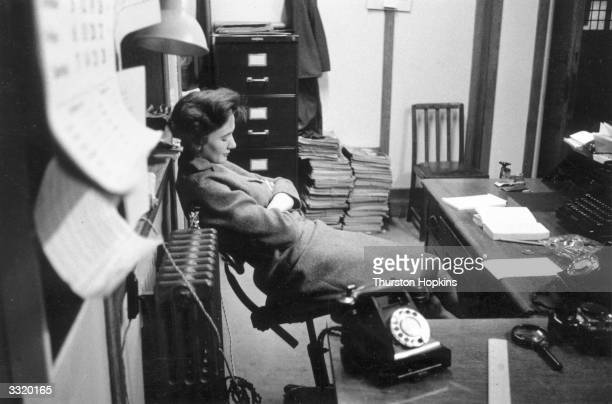 Picture Post office secretary Mrs Barbara Scoble sleeping at her desk unaware that she is being filmed by a hidden camera Original Publication...