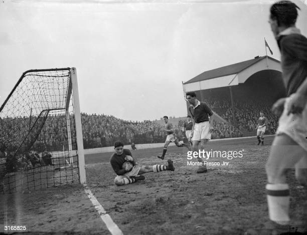 Charlton goalkeeper WIliam Duff saving a shot from a Manchester United corner during their game at the Valley