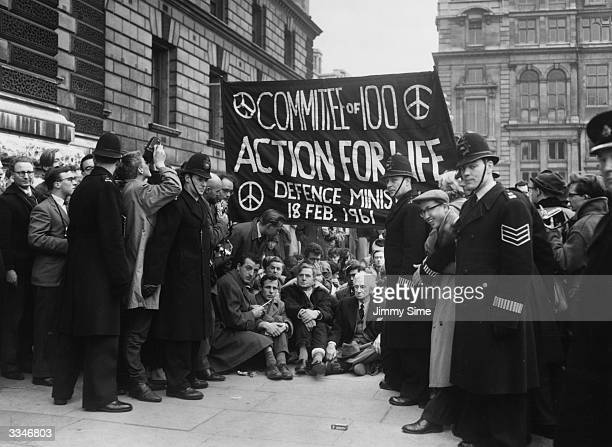 Year-old philosopher Bertrand Russell , foremost voice in Britain for the abolition of nuclear arms, sitting on the pavement with other demonstrators...