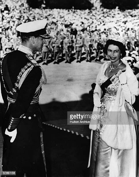Queen Elizabeth and Prince Philip Duke of Edinburgh on the steps of Parliament House Wellington New Zealand before opening the island's Parliament