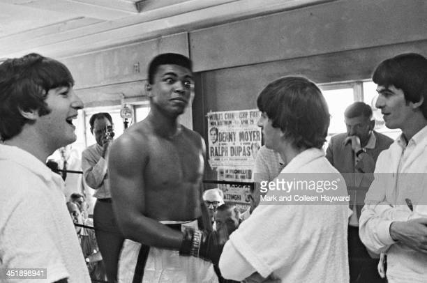 Boxer Cassius Clay meets John Lennon Ringo Starr and George Harrison of The Beatles at his training centre in Miami Florida on 18th February 1964