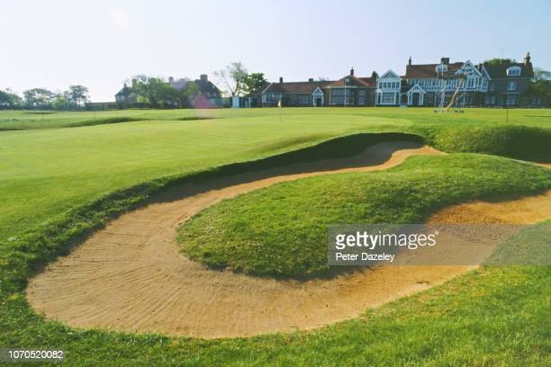 18th hole Muirfield with Club house behind and sandtrap in foreground