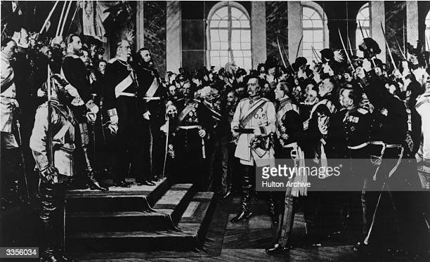 After the defeat of the French in the FrancoPrussian war Bismarck in a white uniform reading a proclamation at Versailles declaring Wilhelm I of...