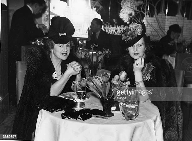 Miss Jeanne Stuart and Mrs Weit enjoying a party at Claridges London thrown by American actor Edward Everett Horton Horton has just completed filming...