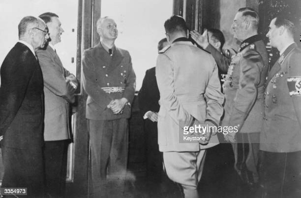 An informal meeting of the Axis Powers alliance leaders. Left to right - Count Paul Teleki , Hitler, Ribbentrop, Galeazzo Ciano, Field Marshal Keitel...