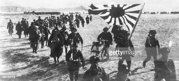 One of the first pictures of the Japanese invasion, as they press forward on the Pacific Shore.
