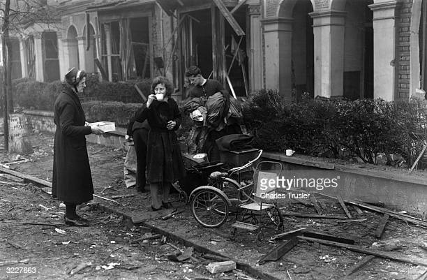 A member of the Salvation Army provides tea for the inhabitants of a bombed house in Lycott Grove Dulwich