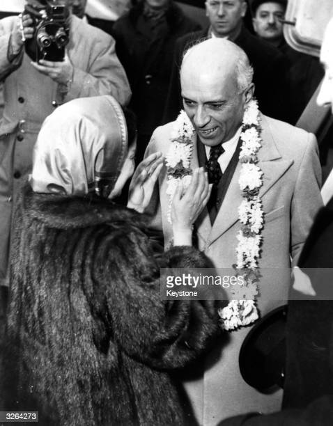 The Indian statesman Jawaharlal Nehru, , appointed first prime minister of India in 1947 when India achieved independence. He is being presented with...