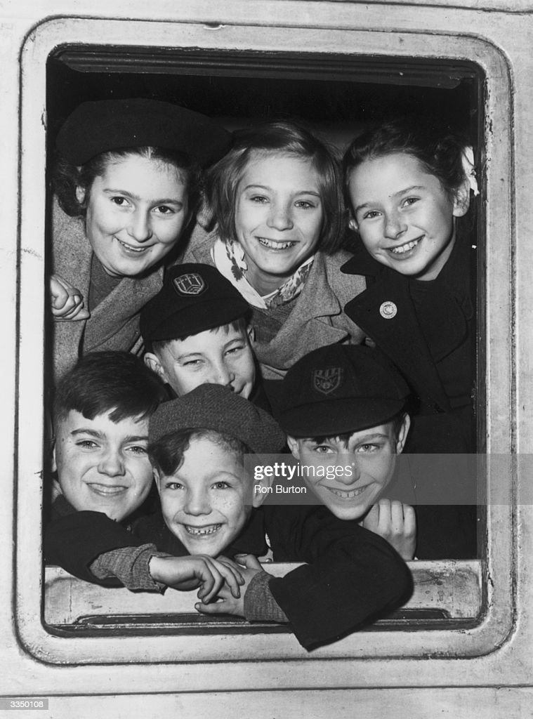 A group of children aged between six and thirteen board a train at London's St Pancras Station, en route to new homes in Australia. Having somehow been deprived of a normal home life, they are being sent abroad by the Church of England Scheme, in the hope of better things.