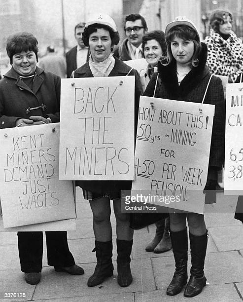 Miners' wives from the Betteshanger colliery in Deal Kent wearing placards to complain about their husbands' pay and supporting their strike outside...