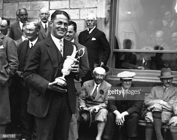 Bobby Jones holding his trophy having won the British Open at St Andrews with a record score of 285. Jones won the British Open three times and the...