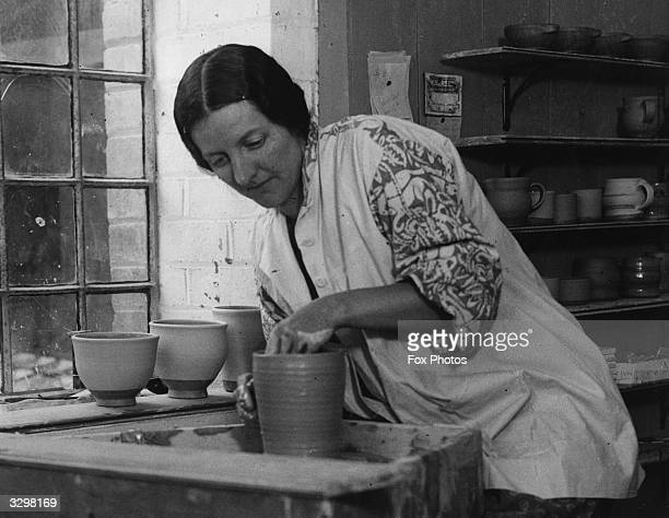 Miss Muriel Bell working in her pottery in St Annes Well She is a pupil of Bernard Leach