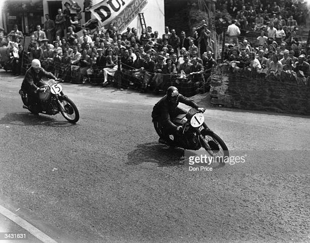 Bell of Ireland on a Norton and E J Frend on an AJS in action at Quarter Point during the Isle of Man Senior TT Race.