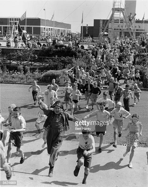 Gordon Mitchell the Butlin's pirate leading children on a hunt for the villainous Captain Thunder on a Butlin's holiday camp in Filey Original...