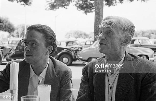 'Picture Post' photographer Kurt Hutton sitting in a cafe during a business trip to Geneva, with the retained dfixer/researcherf Alex Koziell. The...