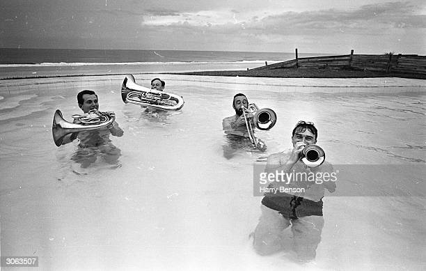 Four musicians from the London Symphony Orchestra play their instruments on Daytona Beach, Florida. They are George Reynolds , Alan Jenkins , David...