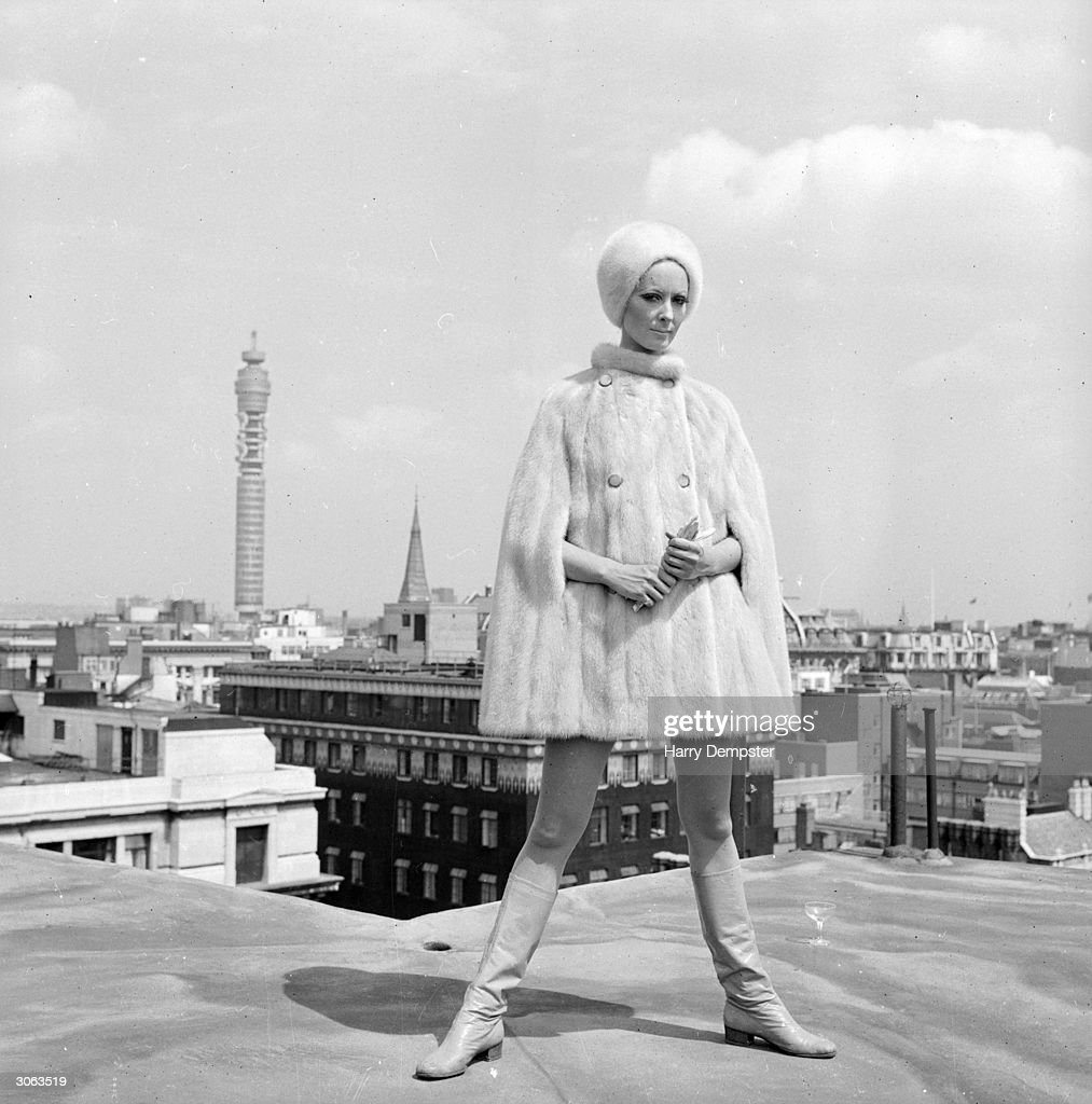 Ruth Dumer models a white mink cape and hat costing ?756 on a rooftop near the Post Office Tower.