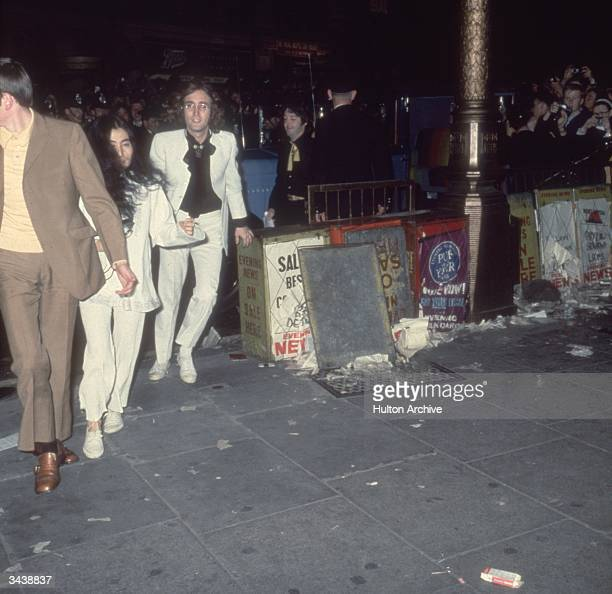 Beatle John Lennon with his Japanese girlfriend Yoko Ono and Paul McCartney arrive at the London Pavilion for the premiere of the new Beatles film...