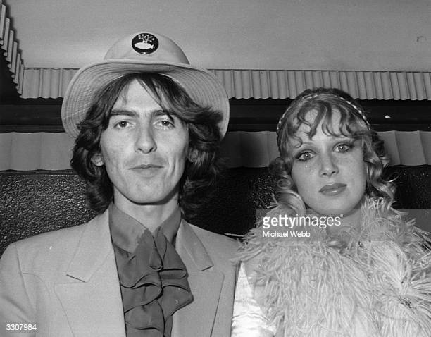 George Harrison of The Beatles and his wife Patti Boyd arriving at the London Pavilion for the world premiere of the new Beatles film 'Yellow...