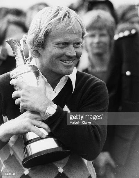 Delighted golfer Jack Nicklaus holding the British Open Golf Championship trophy at St Andrews. It was his second win at the old course and his third...