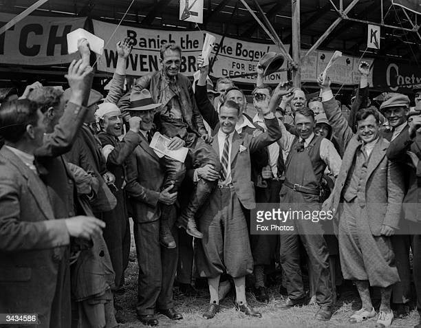 A J Guthrie winner of a TT Lightweight Motorcycle race is hoisted on to the shoulders of supporters