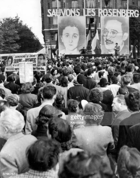 A demonstration at Paris attended by thousands calling for the pardon of US communists Julius and Ethel Rosenberg convicted of passing atomic secrets...