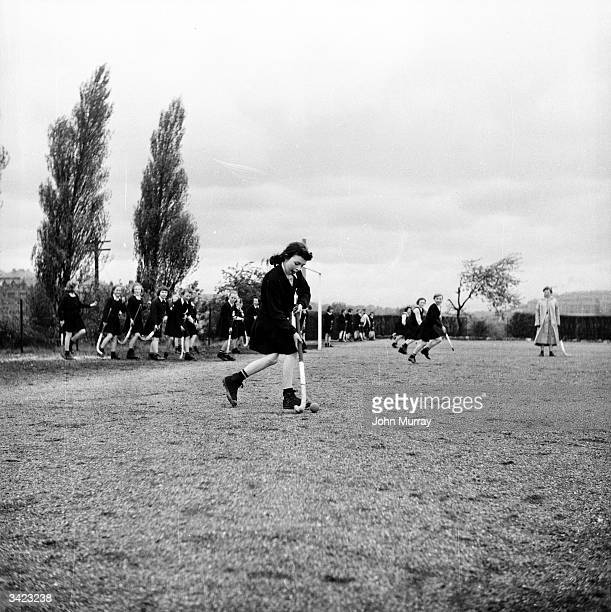 A hockey match in progress on one of the playing fields of the Glasgow High School for Girls Original Publication Picture Post 7807 The School for...