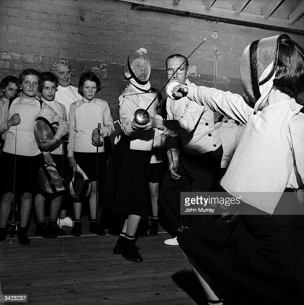 Older pupils at the Glasgow High School for Girls learn the elegant art of fencing with the maitre d'armes Donald Stewart Garnethill Public School...