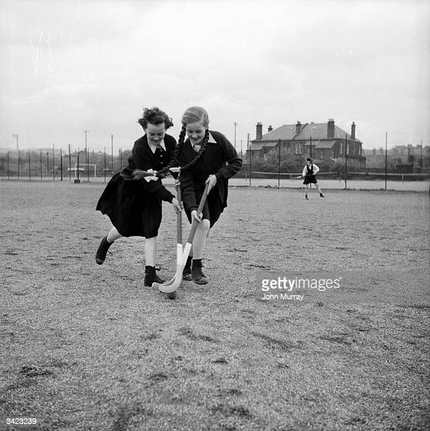 Two pupils at the Glasgow High School for Girls engaged in a competitive game of hockey Garnethill Public School became the Glasgow High School for...
